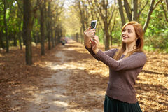 Woman photographing nature in the woods Stock Photos