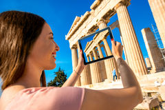 Woman photographing Parthenon temple in Acropolis Stock Images