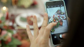 Woman photographing on phone floral fruit composition on table stock footage