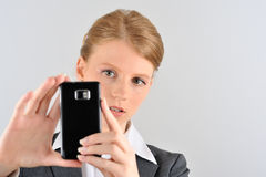 Woman photographing with phone. Red haired woman making pictures. Her eyes are in focus Royalty Free Stock Photo