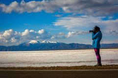 Woman photographing the salinas stock photography