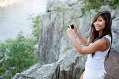 Woman photographing scenic river Stock Photos