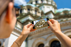 Woman photographing the St. Alexander Nevsky Royalty Free Stock Photography