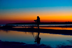 Woman photographing sunset Royalty Free Stock Photography