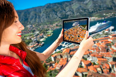 Woman photographing with tablet old city Stock Photos