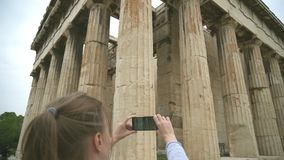 Temple of Hephaestus. Woman photographing Temple of Hephaestus in Athens, Greece stock footage