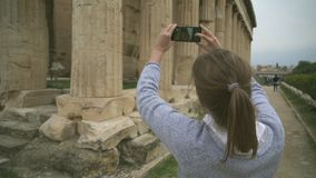 Temple of Hephaestus. Woman photographing Temple of Hephaestus in Athens, Greece stock video footage