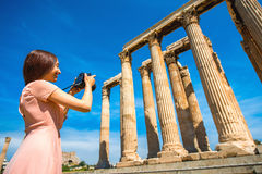 Woman photographing Zeus temple in Acropolis Stock Photography