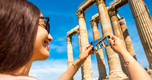 Woman photographing Zeus temple in Greece Stock Image