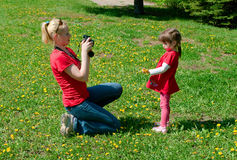 Woman photographs the daughter Royalty Free Stock Images