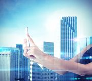 Woman photographs futuristic city Royalty Free Stock Image