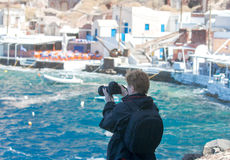 Woman photographs the harbor. royalty free stock photo