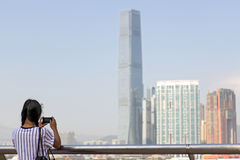 Woman photographs Hong Kong Royalty Free Stock Photos