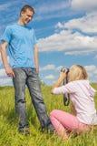 Woman photographs man Royalty Free Stock Photography