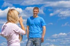 Woman photographs man Stock Photos