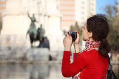 Woman photographs monument to Don Quixote Stock Photography