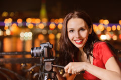 Woman photographs night landscape Stock Photo