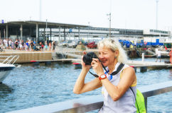 Woman photographs on the quay Stock Photography