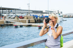 Woman photographs on the quay Stock Photo