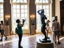 Woman photographs sculpture in Rodin Museum, Paris, France Stock Images