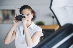 Woman photography professional taking a studio picture Royalty Free Stock Images
