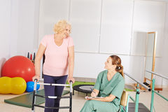 Woman in physical therapy in nursing home. Elderly women with walker in physical therapy in nursing home Stock Image