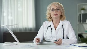 Woman physician holding online consultation of patient using modern technologies. Stock footage stock footage