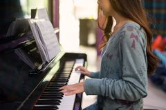 Woman pianist play classic Piano. Attractive woman pianist playing on classic Piano keyboard at sunset. Closeup fingers to music instruments. Happy leisure and stock photo
