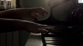 Pianists hand opens grand piano and starts playing music close up in slow motion. Woman pianists two hand opens the grand piano and starts vigorously playing stock video