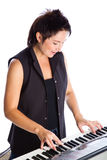 Woman with piano. Young woman with piano on white background Royalty Free Stock Photo