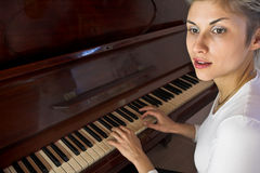 Woman and piano Royalty Free Stock Photo