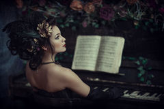 Woman with piano Royalty Free Stock Images