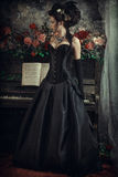 Woman with piano Stock Images