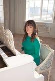 Woman at the piano Royalty Free Stock Image