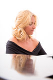 Woman piano player Royalty Free Stock Image