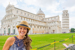 Woman on piazza dei miracoli, pisa, tuscany, italy. Portrait of happy young woman on piazza dei miracoli, pisa, tuscany, italy Royalty Free Stock Photos