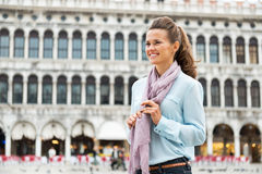 Woman on piazza san marco in venice, italy Stock Photos