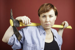 Woman with pickaxe Royalty Free Stock Images