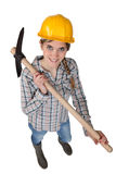Woman with a pickaxe Royalty Free Stock Image