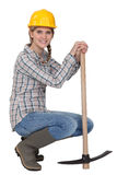 A woman with a pickaxe. Stock Photography