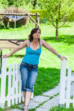 Woman at a picket fence Stock Photos