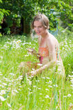 Woman pickin ox eye daisy flowers Stock Photos