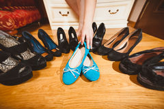 Woman picking ballet flats rather than high heels Royalty Free Stock Image
