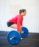 Woman Picking Barbell Stock Images