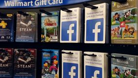Woman picking the facebook game gift card