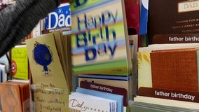 Woman picking father birthday card for dad stock video footage