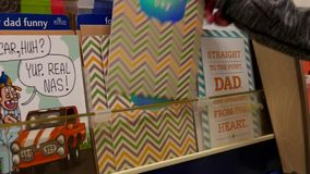 Woman picking father's day card for dad stock video