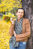 Woman Picking Leaves in Autumn Royalty Free Stock Photo