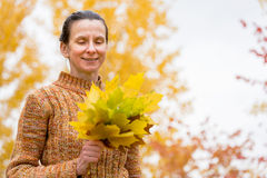 Woman Picking Leaves in Autumn Royalty Free Stock Photos