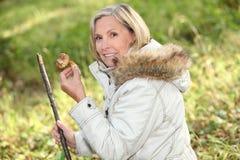 Woman picking mushrooms Royalty Free Stock Photo